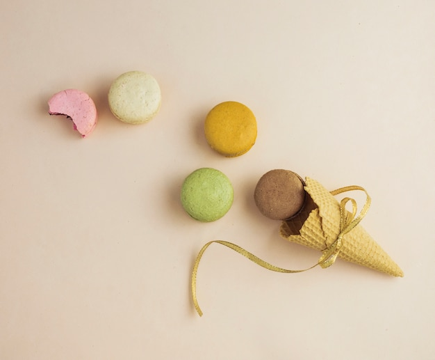 Top view tied ice cream cone with macarons