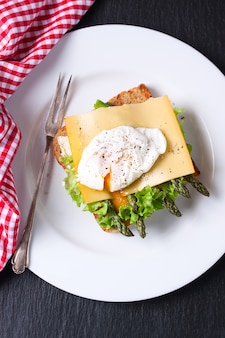 Top view of toast with asparagus and cheese