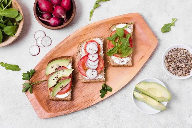 Top view of toast with variety of vegetables