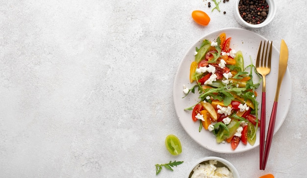 Top view tomato mix salad with feta cheese and copy-space