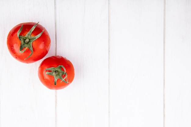 Top view of tomatoes on wooden surface