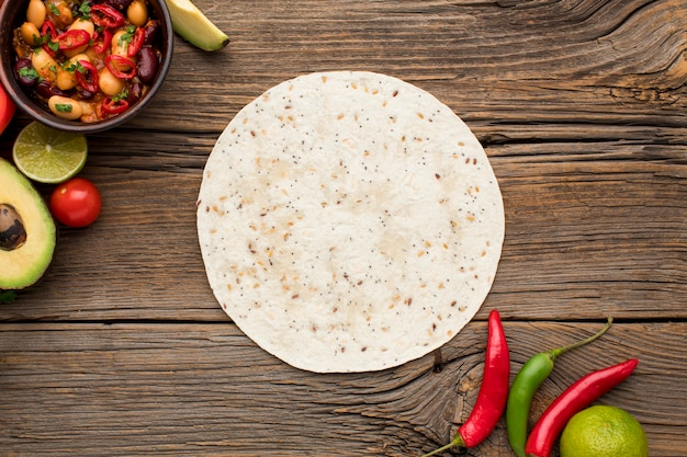 Top view tortilla with fresh mexican food