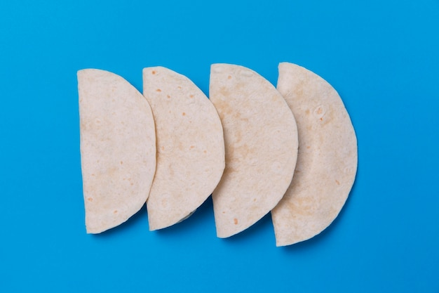 Top view tortillas on blue background