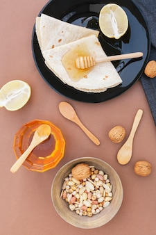 Top view tortillas with honey and lemon