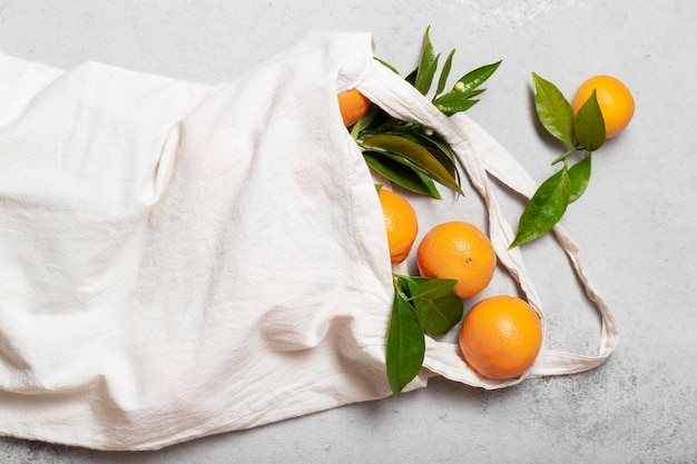 Top view tote bag with oranges