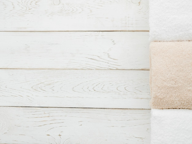Top view towels on wooden background with copyspace