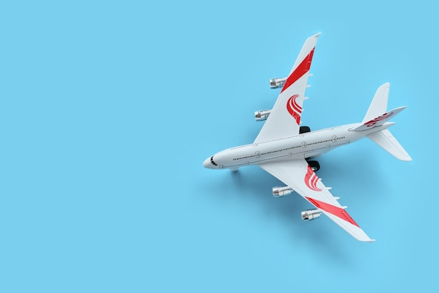 Top view of toy airplane on a blue background
