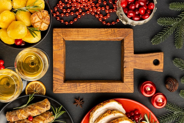 Top view traditional christmas cuisine arrangement with chalkboard