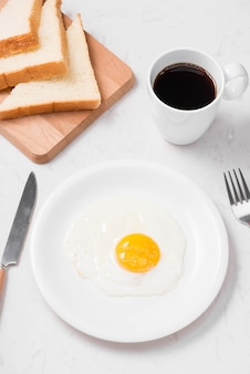 Top view of traditional healthy easy quick breakfast meal made of fried eggs served on a plate.
