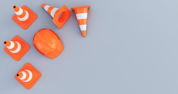 灰色の背景で隔離の上面図のトラフィックコーンとオレンジ色のヘルメット