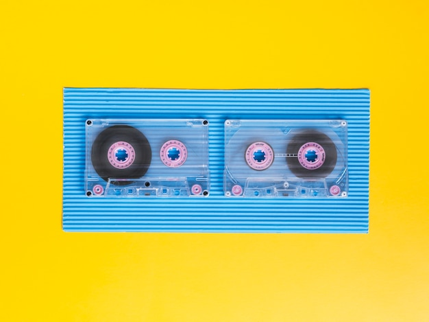 Top view transparent cassette tapes on vibrant background