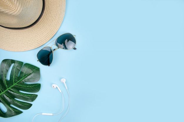 Top view of travel accessories with sun glasses,