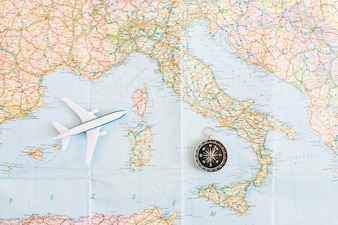 Top view travel background with plane on map