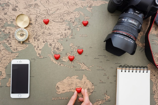 Top view of travel composition and red hearts
