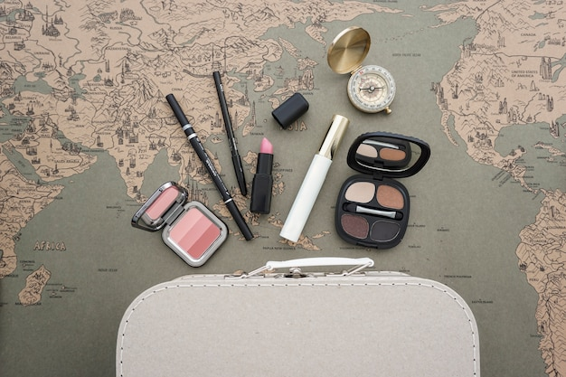Top view of travel composition with beauty elements