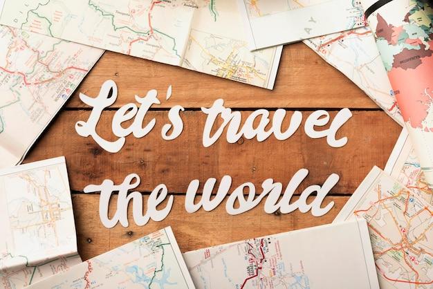 Concetto di viaggio vista dall'alto con mappe del mondo