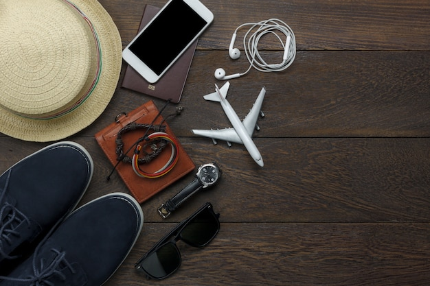 Top view travel elements on wooden background
