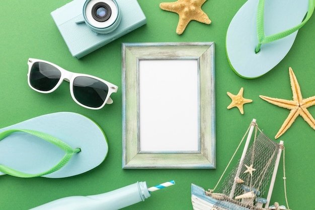 Top view travel items on green background