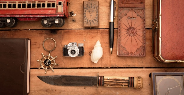 Top view travel items on wooden table