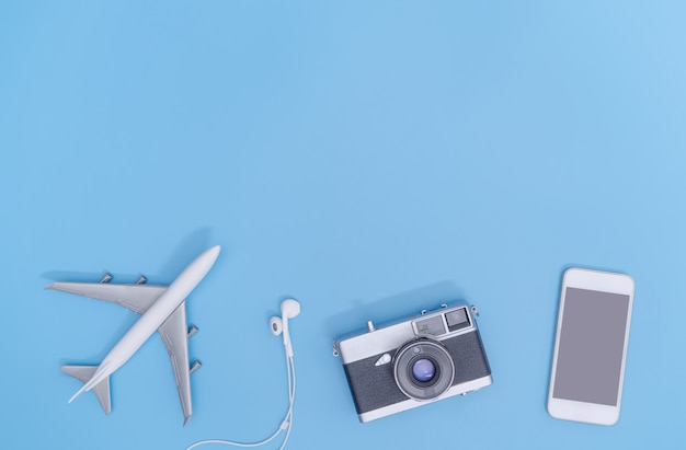Top view travel objects on blue background for poster and banner
