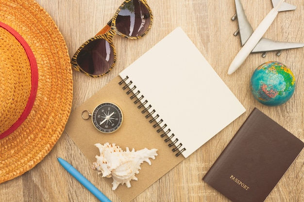 Top view of traveler's accessories and essential vacation items.travelling planning on holiday concept.