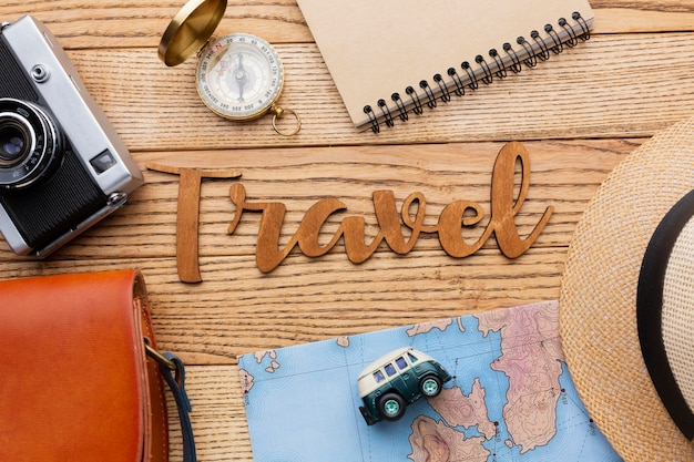 Top view traveling items on wooden background