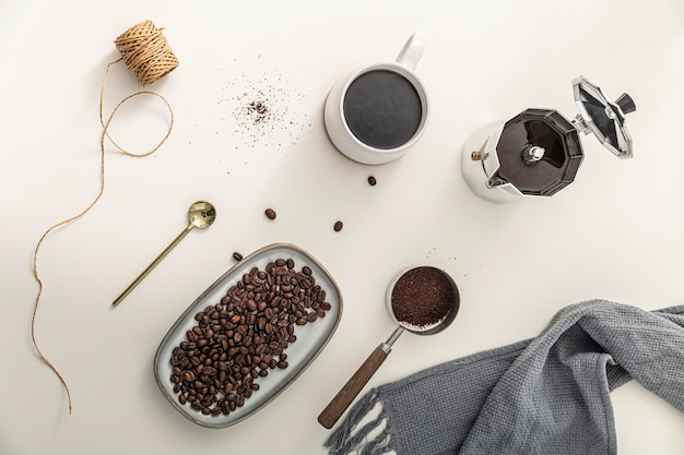 Top view of tray with coffee beans and mug