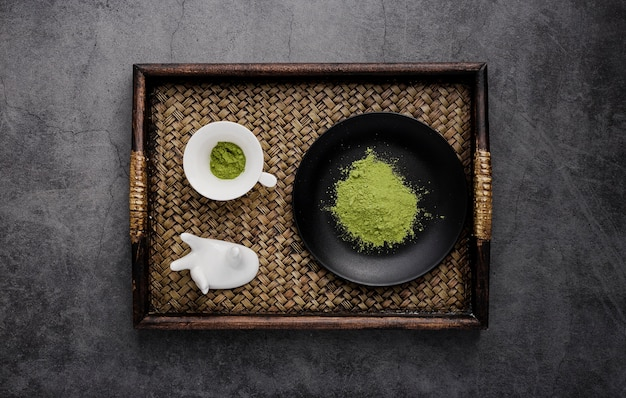Top view of tray with matcha tea and plate