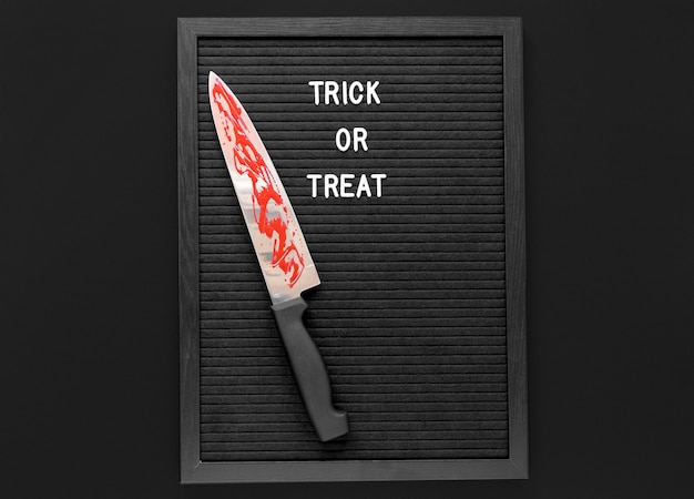 Top view trick or treat with knife