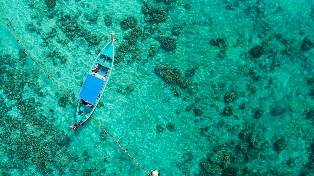 Top view tropical island , aerial view of long-tailed boat on the sea in phuket thailand.