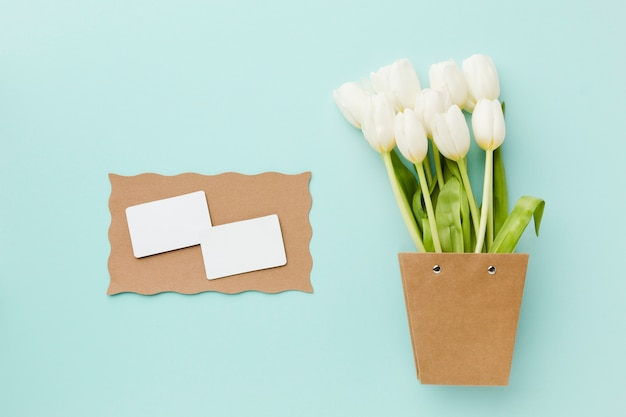 Top view tulip white flowers and empty white cards