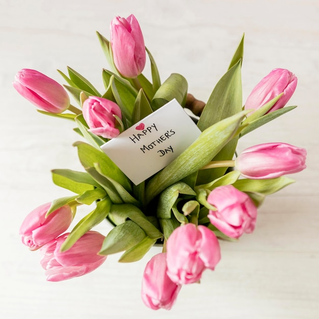 Top view tulips arrangement with card