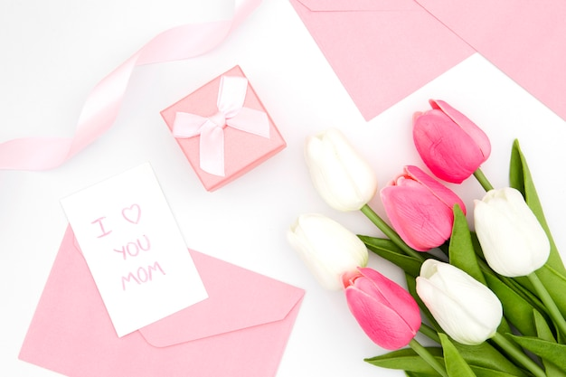 Top view of tulips bouquet and envelope
