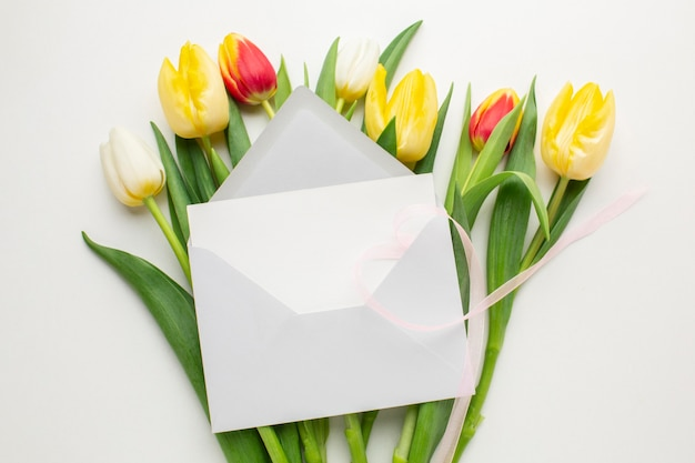 Top view tulips flowers with envelope