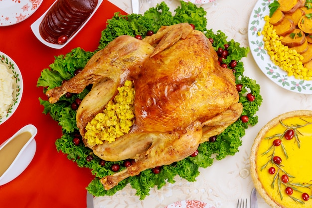 Top view of turkey, decorated with kale and cranberry for christmas dinner. holiday new year concept.