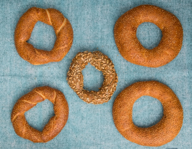 Top view of turkish bagels on blue background with copy space