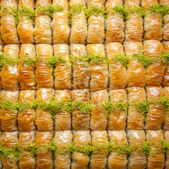 Top view turkish baklava pattern dessert made of thin pastry, nuts and honey