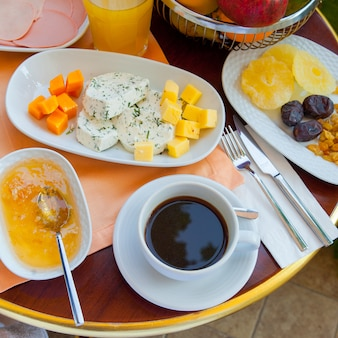 Top view turkish breakfast with coffee, honey and others.