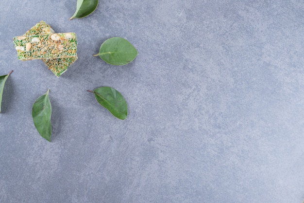 Top view of turkish delight rahat lokum with hazelnuts on grey background.
