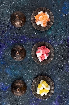Top view of turkish delights on blue surface