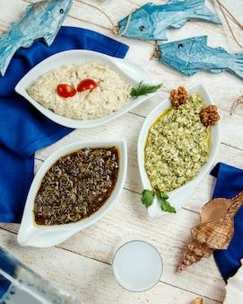 Top view of turkish side dishes platter and turkish raki