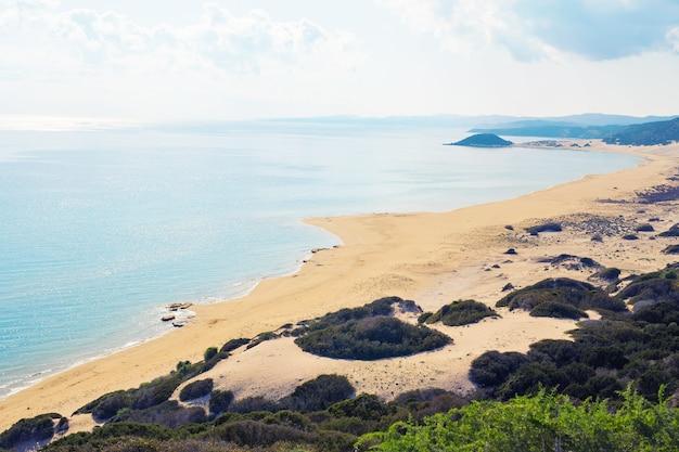 Top view of turtle beach karpaz, north cyprus. golden sand beach and mediterranean sea in north cyprus
