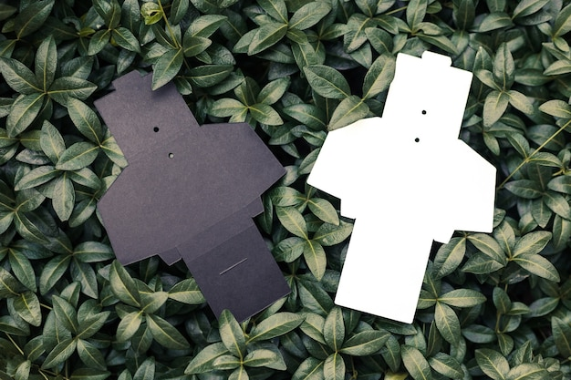 Top view of two black and white empty unfolded box for accessories for sewing tags for clothes on ba...