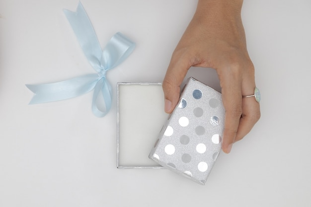 Top view two hands holding and open the empty gift box isolated white background