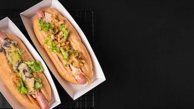 Top view of two hot dogs with copy space