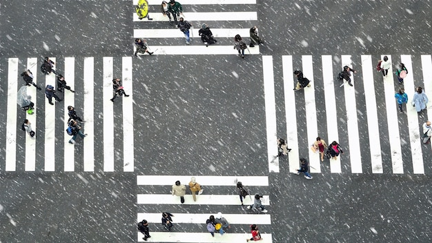 Top view of undefined japanese people crowd are walking to crosses