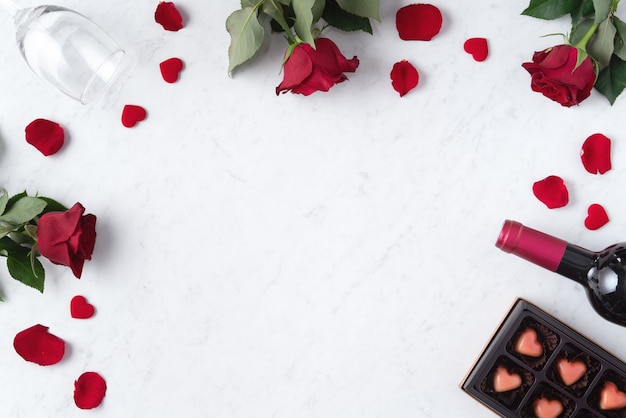 Top view of valentine day chocolate with rose and wine, festive gift design concept for special holiday dating.
