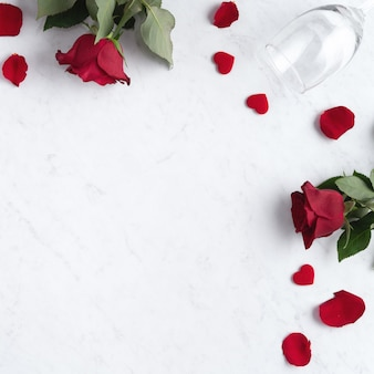 Top view of valentine day concept with rose and wine, festive gift design concept for special holiday dating.
