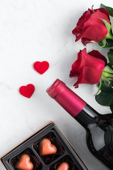 Top view of valentine's day chocolate with rose and wine