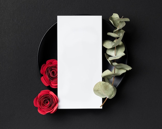 Top view of valentine's day roses with plate and blank card